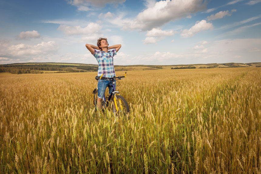young man in the fields