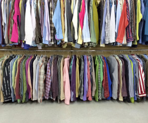 Colorful clothes for sale in a second hand store.